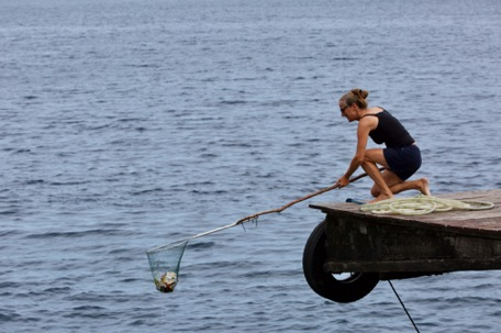 Karin helps with the daily rubbish-fishing