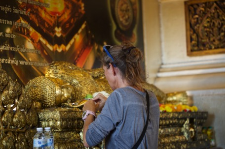 ... and stick gold on Buddhastatues, for luck and good health